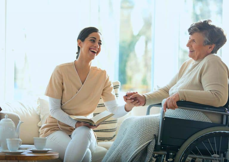 coast nutrition - carer and elderly patient laughing
