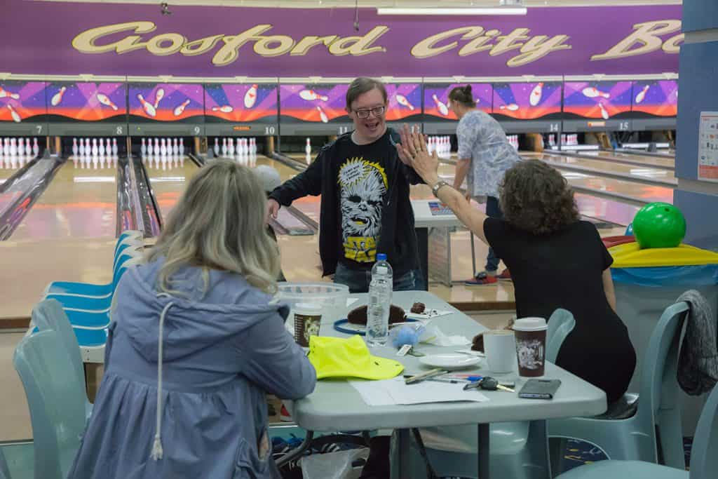 mental health programs - group playing bowling